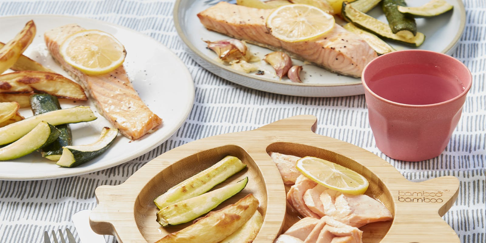 One-pan salmon with zucchini and potato wedges